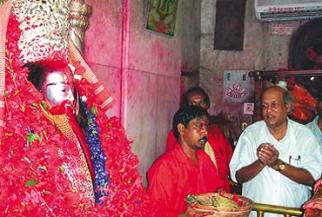 West Bengal CPI-M leader Subhas Chakraborty praying at a Kali Temple